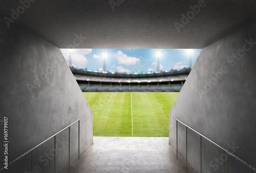 tunel na stadionie z zielonym polu