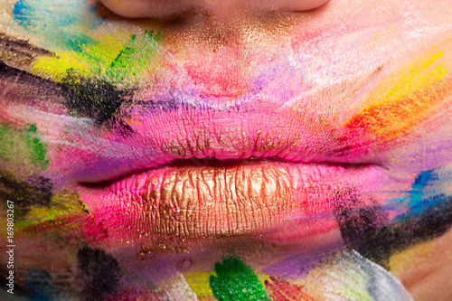 Lips in close up with colors all over the mouth Poster