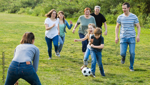 Fotobehang Voetbal people of different ages playing football