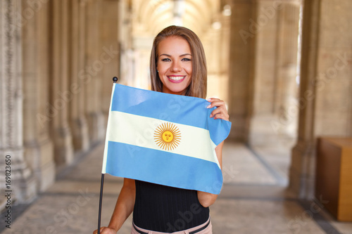 Spoed canvasdoek 2cm dik Buenos Aires Young woman smile with flag of Argentina