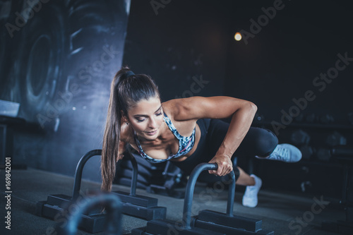 Sticker Beautiful athletic woman - fitness workout in gym.