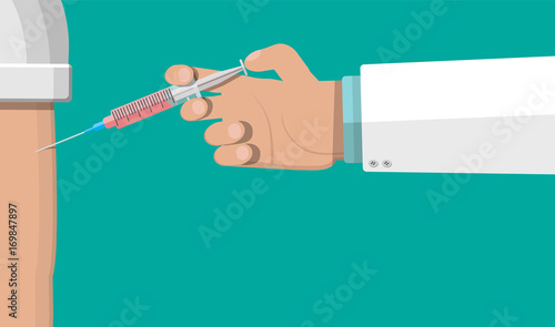 Doctor hand with syringe, vaccination of patient.