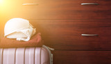 A suitcase with things on the background of a travel concept wardrobe - 169856615