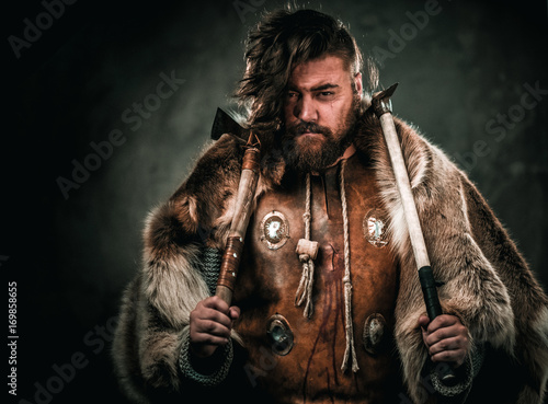 Viking with cold weapon in a traditional warrior clothes Poster