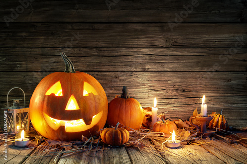 Halloween Pumpkins And Candles On Wooden - 169876611