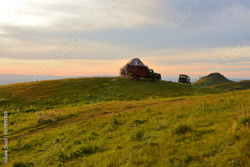Fotobehang Bleke violet Horse pastures with urta
