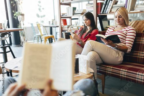 Friends reading books