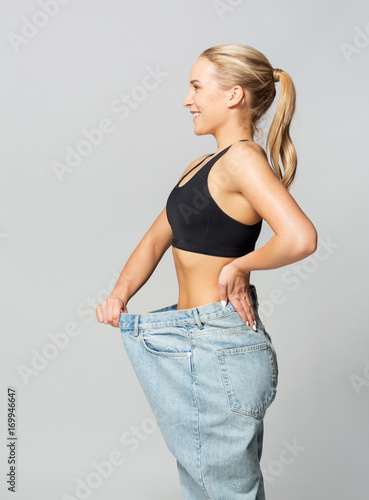 young slim sporty woman in oversize pants