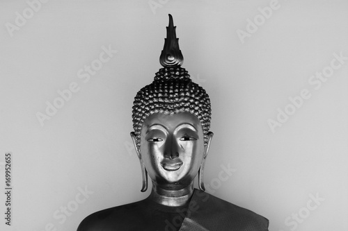 Fotobehang Boeddha Face of buddha statue - light and shadow