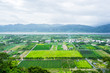 Panoramic bird eye aerial view of beautiful field and mountain under fantasy cloudy sky in Luyeh Hill, Taitung, the famous attractions in Taiwan