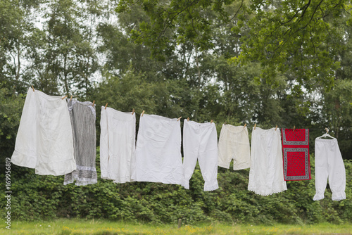 Old-fashioned clothesline with clothing.