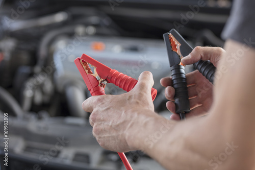 Charging car battery from another car with a set of jumper cables