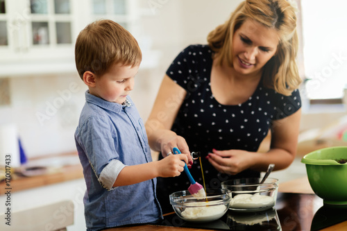 Beautiful child and mother baking