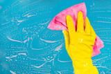 hand with a rag cleans the surface - 170020027