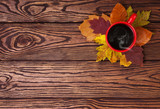 Autumn leaves and cup of coffee