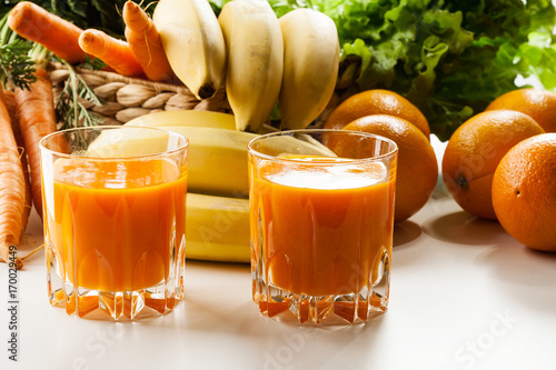 Fotobehang Sap Glass of fruit juice with orange, carrots and banana