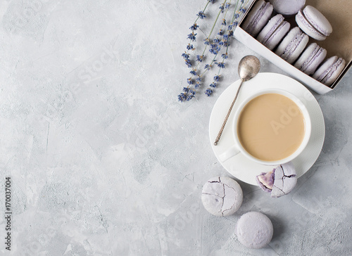 Poster Macarons in box and on table with cup of coffee and lavender.