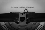 Text Private and Confidential typed on retro typewriter - 170038493