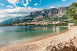 Coast, sea and beach below the mountain Biokovo in the town of Makarska in Croatia - 170039275