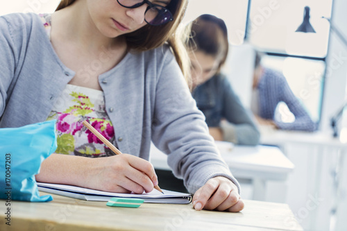 Papiers peints Kiev Student girl writing test in classroom