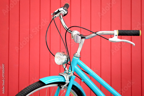Fotobehang Fiets retro bicycle in front of the red wall background