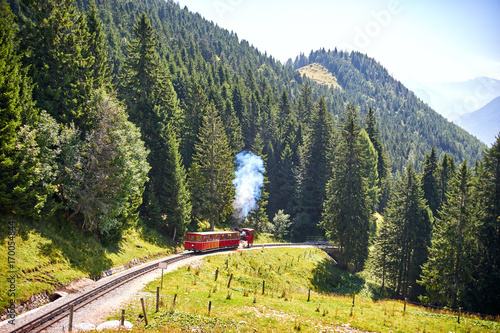 Excursion red train in mountains