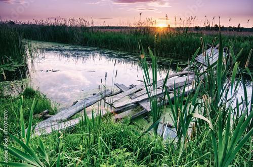 Fotobehang Lichtroze Rural summer sunrise landscape with river, wooden bridge, retro vintage style