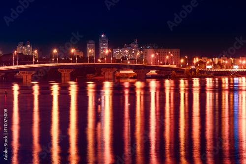 Fotobehang Kiev Havana bridge in Kiev at night with colorful illumination and reflection in Dnieper river