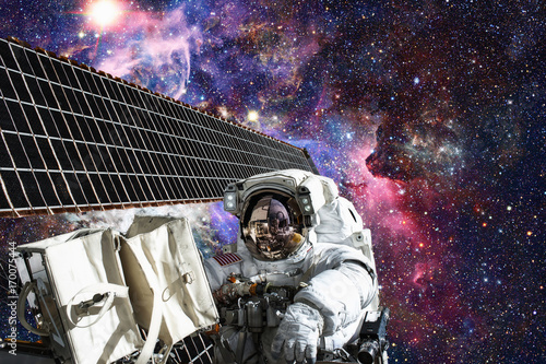 Fotobehang Heelal Astronaut in outer space. Spacewalk. Elements of this image furnished by NASA