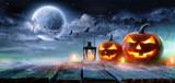 Jack O' Lanterns Glowing At Moonlight In The Spooky Night - Halloween Scene  - 170078290