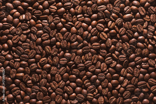 Roasted coffee beans on a flat background. - 170084028