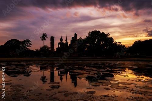 Fotobehang Thailand Big buddha in sunset at Sukhothai Historical Park, Sukhothai, Thailand