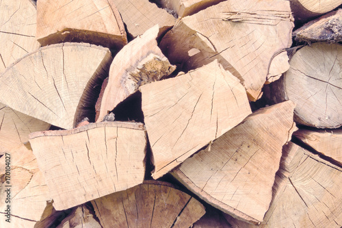 Papiers peints Texture de bois de chauffage background texture pinned logs logs of beech, oak, aspen, alder are stacked and prepared for winter close-up under the background or inscription