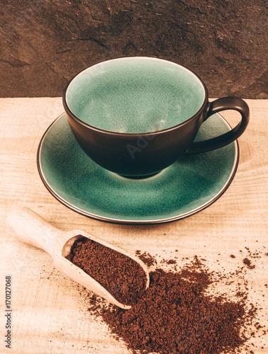 Foto op Plexiglas Koffiebonen Ground coffee on the wooden background.