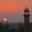 Sunset behind a muslim mosque minaret