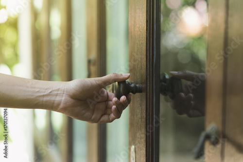 hand hold handle of door, close up Poster