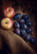 still life with apples and plums