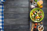fresh greek salad in plate and ingredients - 170139856