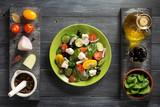 fresh greek salad in plate and ingredients - 170139875