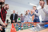 People playing table soccer - 170143680