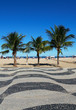 Quadro Copacabana and the famous geometric boardwalk and coconut trees on the beach