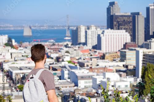 Fotobehang San Francisco Man Overlooks San Francisco Skyline with Bay Bridge