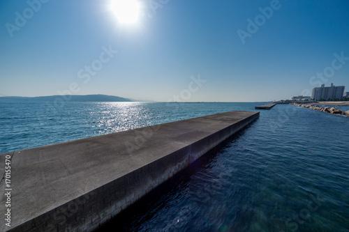 Aluminium Blauwe jeans 海沿いの街