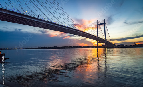 Vidyasagar Setu - the cable stayed bridge on river Hooghly at sunset with water reflections