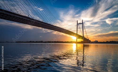 Fridge magnet Vidyasagar Setu - the cable stayed bridge on river Hooghly at sunset with moody sky.