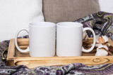 Two white mugs, pair of cups on a wooden tray, the Mockup. Cozy home, wooden background, cotton and wool decorations, winter gifts - 170161676