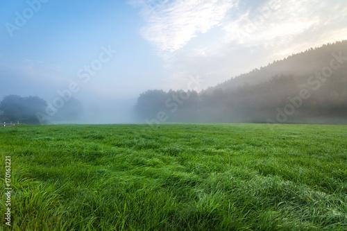 Aluminium Zomer Blue sky with landscape in fog
