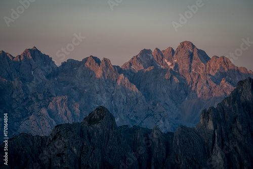 Leinwandbild Motiv Sunrise over the ridges of Dolomites