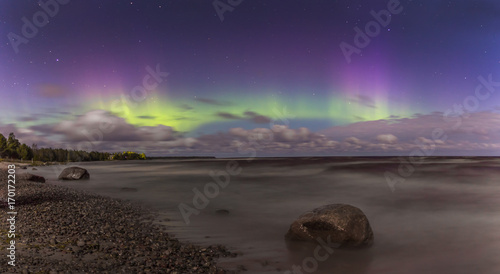 Fotobehang Aubergine Northern lights on lake Ladoga. Leningrad oblast. Russia