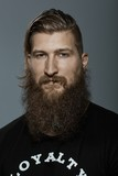 Portrait of a serious young bearded man